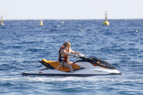 Lindsay Lohan practices jet ski during vacation in Ibiza