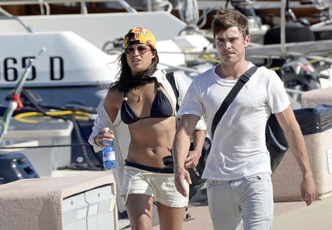 UNLIKELY FRIENDS! Zac Efron and Michelle Rodriguez are seen getting off a boat together after enjoying the sun and the ocean on a boat in Porto Cervo, Sardinia