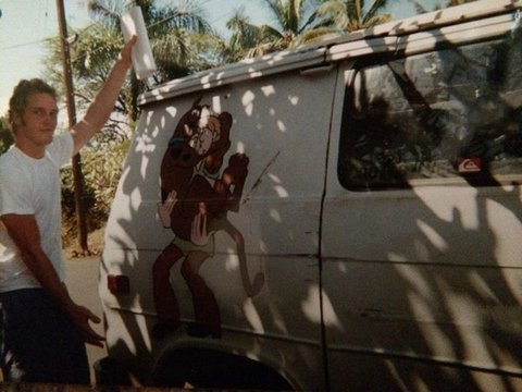 Chris Pratt next to the Scooby-Doo van he used to live in.