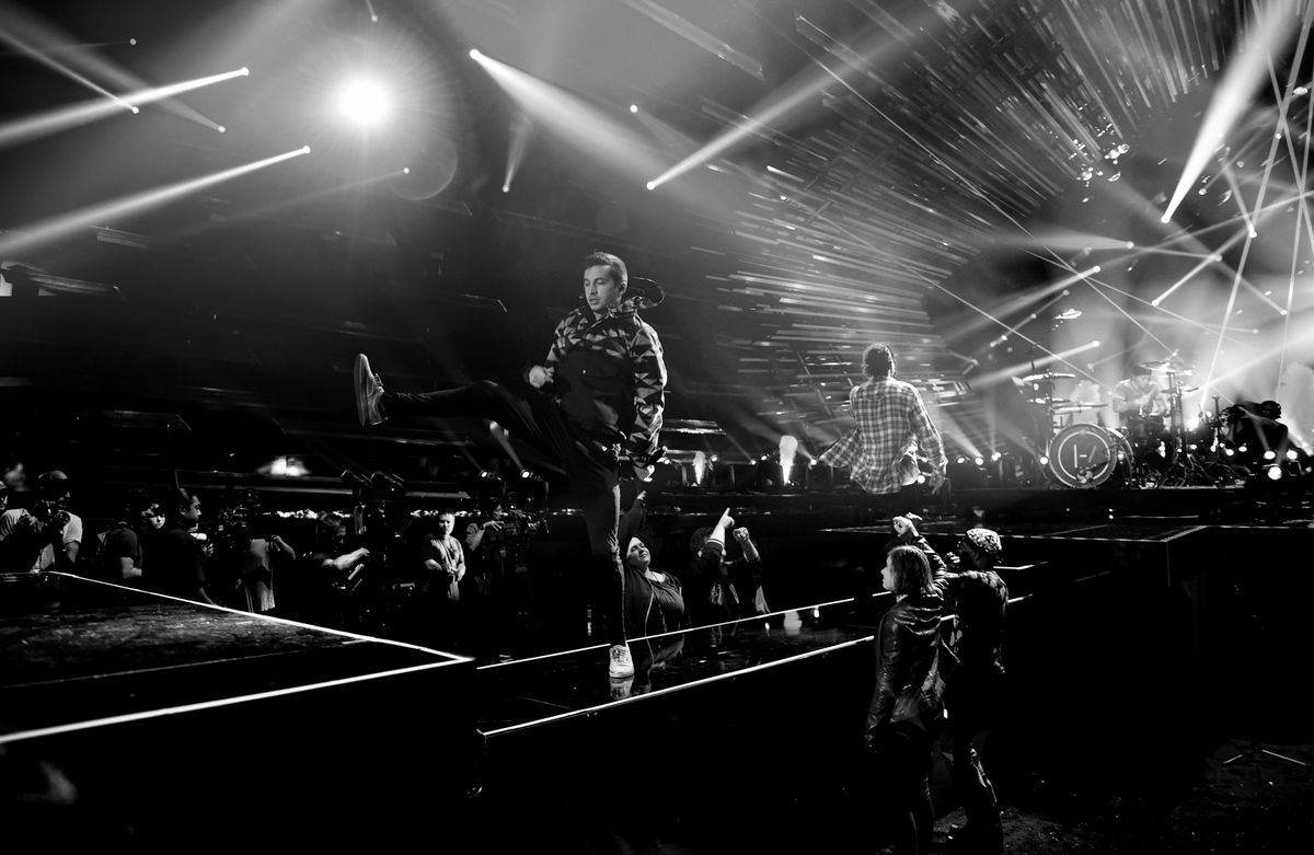 LOS ANGELES, CA - AUGUST 29:  (EDITORS NOTE: This image has been converted to black and white.)  Rapper ASAP Rocky (C) rehearses onstage with Tyler Joseph (L) and Josh Dun (R) of Twenty One Pilots for the 2015 MTV Video Music Awards at Microsoft Theater on August 29, 2015 in Los Angeles, California.  (Photo by John Shearer/Getty Images for MTV.com)