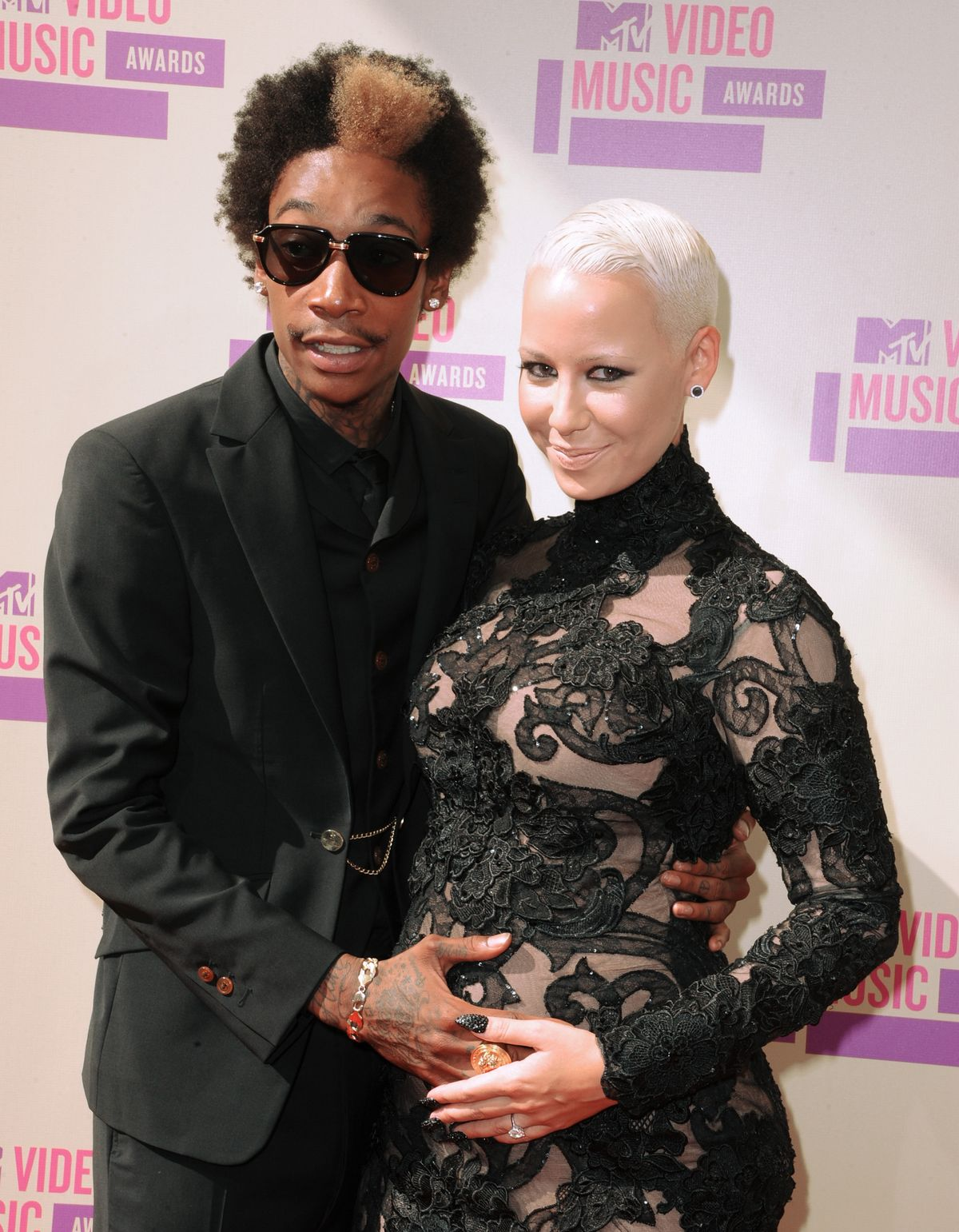 LOS ANGELES, CA - SEPTEMBER 06: (L-R) Rapper Wiz Khalifa and model Amber Rose arrives at the 2012 MTV Video Music Awards at Staples Center on September 6, 2012 in Los Angeles, California. (Photo by Steve Granitz/WireImage)