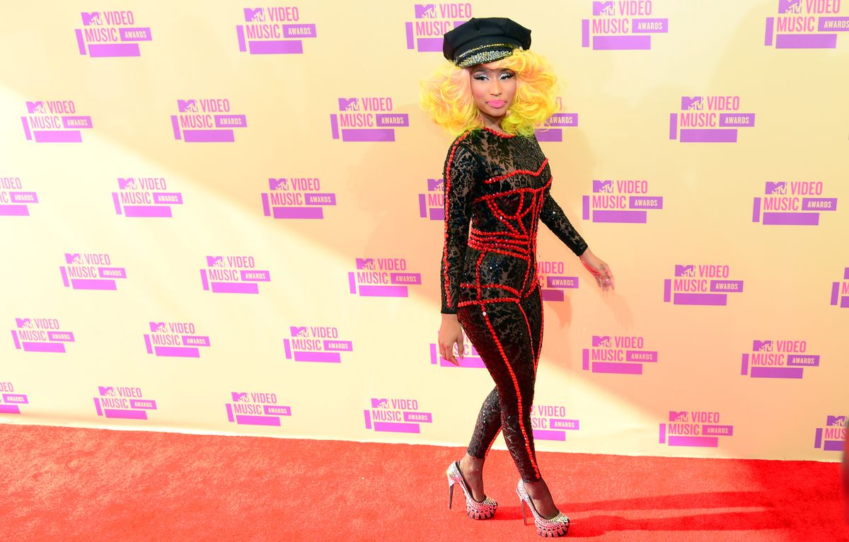 Nicki Minaj poses on arrival on the red carpet for the MTV Video Music Awards in Los Angeles on September 6, 2012 in California. AFP PHOTO / Frederic J. BROWN (Photo credit should read FREDERIC J. BROWN/AFP/GettyImages)