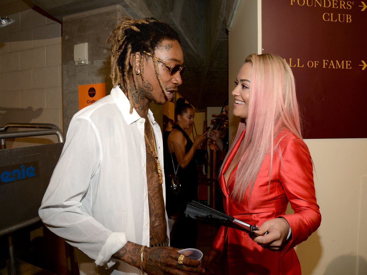 LOS ANGELES, CA - AUGUST 16: Rapper Wiz Khalifa (L) and actress/singer Rita Ora attend the Teen Choice Awards 2015 at the USC Galen Center on August 16, 2015 in Los Angeles, California. (Photo by Kevin Mazur/Fox/WireImage)