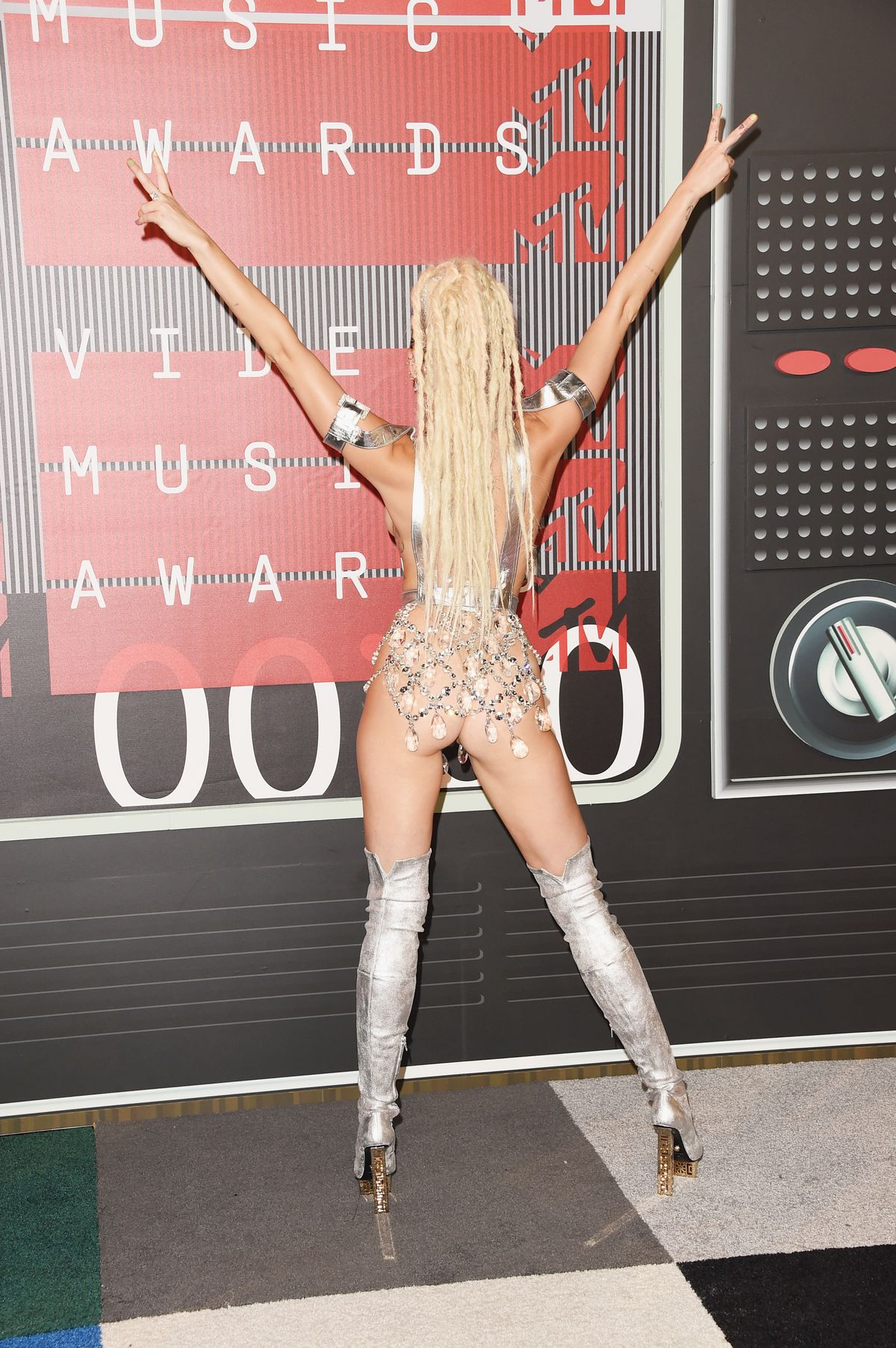 LOS ANGELES, CA - AUGUST 30: (EDITORS NOTE: Image contains nudity.) Host Miley Cyrus attends the 2015 MTV Video Music Awards at Microsoft Theater on August 30, 2015 in Los Angeles, California. (Photo by Jason Merritt/Getty Images)