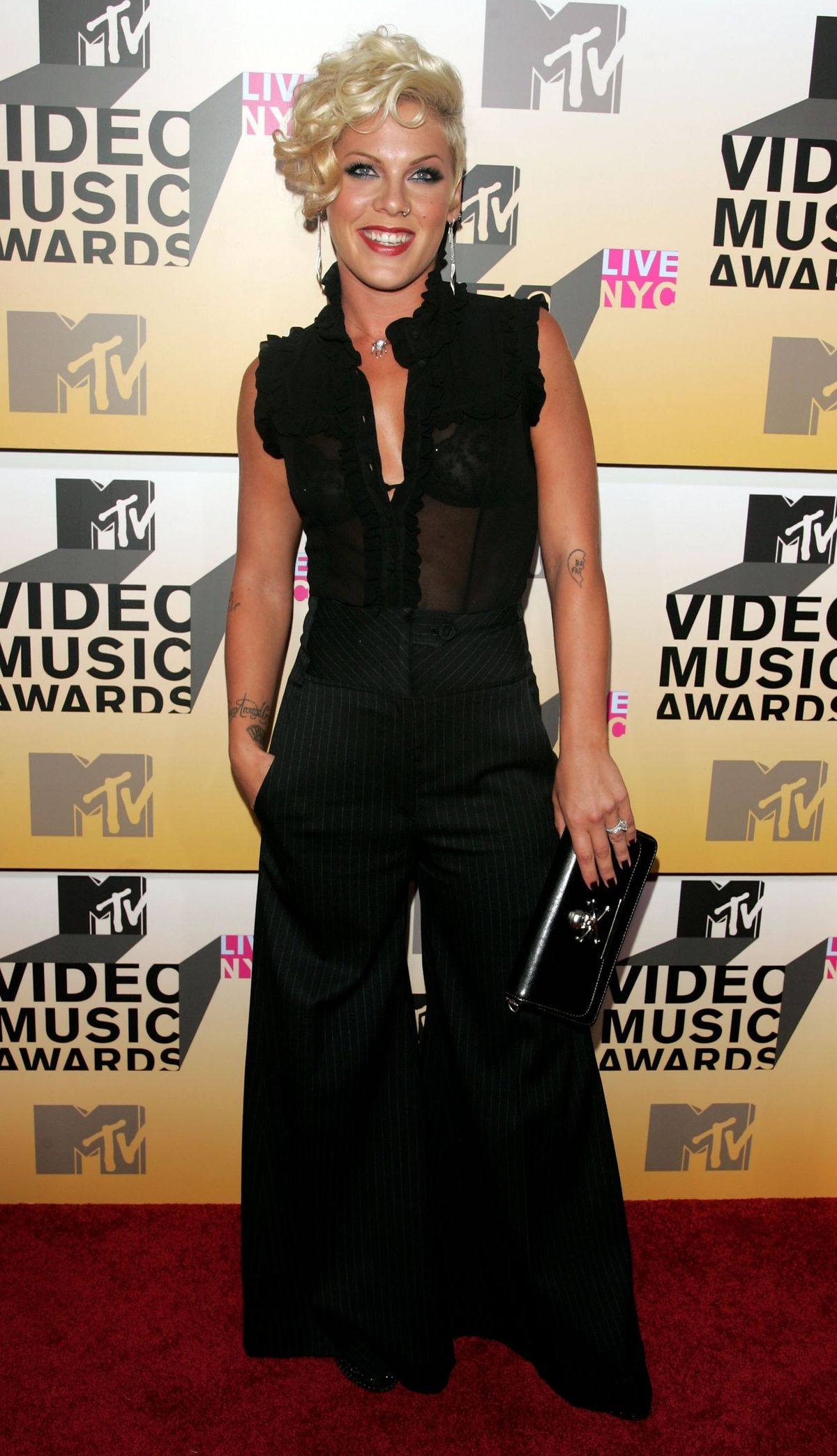 NEW YORK - AUGUST 31:  Singer Pink attends the 2006 MTV Video Music Awards at Radio City Music Hall August 31, 2006 in New York City.  (Photo by Peter Kramer/Getty Images)