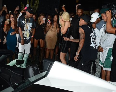 Tyga Gifts Kylie Jenner With a Brand New Ferrari at Bootsy Bellows Pictured: Tyga, Kylie Jenner Ref: SPL1098716  100815   Picture by: All Access Photo Group Splash News and Pictures Los Angeles:310-821-2666 New York:212-619-2666 London:870-934-2666 photodesk@splashnews.com