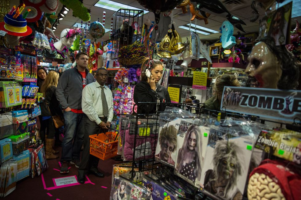 ARLINGTON, VA - OCT30: Shoppers wait in line to pay for Halloween costumes, October, 30, 2014, at Total Fright, in Ballston Common Mall, in Arlington, VA. Photo by Evelyn Hockstein/For The Washington Post via Getty Images)