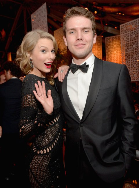 BEVERLY HILLS, CA - JANUARY 12: Singer Taylor Swift (L) and Austin Swift attend The Weinstein Company & Netflix's 2014 Golden Globes After Party presented by Bombardier, FIJI Water, Lexus, Laura Mercier, Marie Claire and Yucaipa Films at The Beverly Hilton Hotel on January 12, 2014 in Beverly Hills, California. (Photo by Charley Gallay/Getty Images for The Weinstein Company)