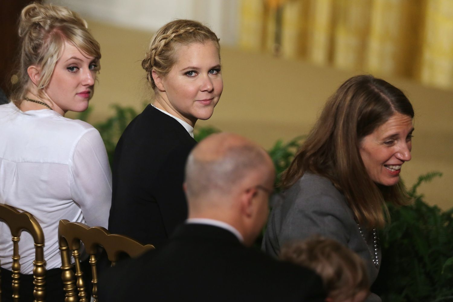 WASHINGTON, DC - JANUARY 05: Comedian Amy Schumer (C) and Health and Human Services Secretary Sylvia Mathews Burwell (R) wait for the arrival of U.S. President Barack Obama before he delivers remarks about his efforts to increase federal gun control in the East Room of the White House January 5, 2016 in Washington, DC. Without approval from Congress, Obama is sidestepping the legislative process with executive actions to expand background checks for some firearm purchases and step up federal enforcement of existing gun laws. (Photo by Chip Somodevilla/Getty Images)