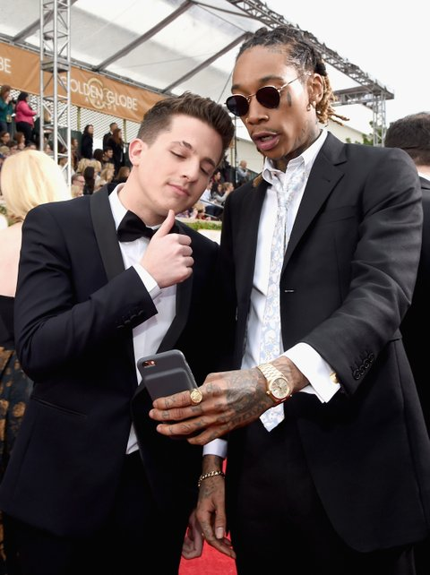 BEVERLY HILLS, CA - JANUARY 10: 73rd ANNUAL GOLDEN GLOBE AWARDS -- Pictured: (l-r) Recording artists Charlie Puth and Wiz Khalifa arrive to the 73rd Annual Golden Globe Awards held at the Beverly Hilton Hotel on January 10, 2016. (Photo by Larry Busacca/NBC/NBCU Photo Bank via Getty Images)
