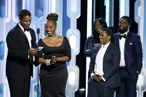 BEVERLY HILLS, CA - JANUARY 10: In this handout photo provided by NBCUniversal, Denzel Washington accepts with Cecil B. Demille Award with his family during the 73rd Annual Golden Globe Awards at The Beverly Hilton Hotel on January 10, 2016 in Beverly Hills, California. (Photo by Paul Drinkwater/NBCUniversal via Getty Images)