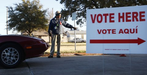 Donald Davis, campus monitor at Morningside Elementary School, directs traffic before the start of the school day as voters and students+= parents try to get into the school on primary day, Tuesday, March 4, 2008, in Fort Worth, Texas.  (Photo by Ralph Lauer/Fort Worth Star-Telegram/MCT via Getty Images)