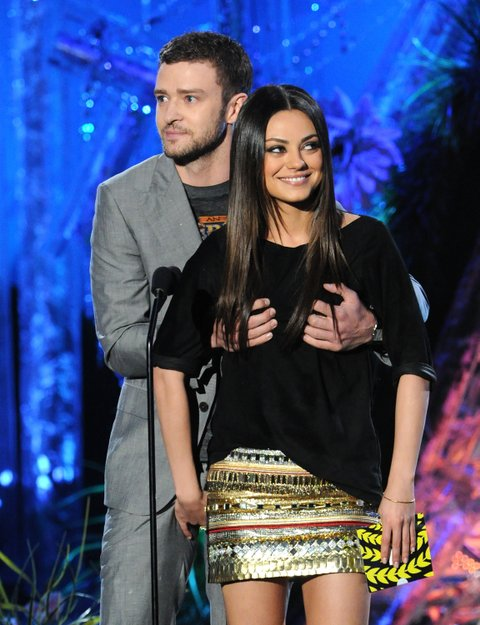 Actor/singer Justin Timberlake and actress Mila Kunis speak onstage during the 2011 MTV Movie Awards at Universal Studios' Gibson Amphitheatre on June 5, 2011 in Universal City, California.