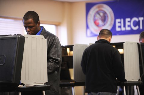 (ml) cd04voting_bb_21 -- Denver native Thomas Richardson, a 19 year old architecture student at Howard University, votes at the Denver Elections Division after he flew back to Denver to vote because he did not receive his mail ballot. (Photo by Brian Brainerd / The Denver Post)  (Photo By Brian Brainerd/The Denver Post via Getty Images)