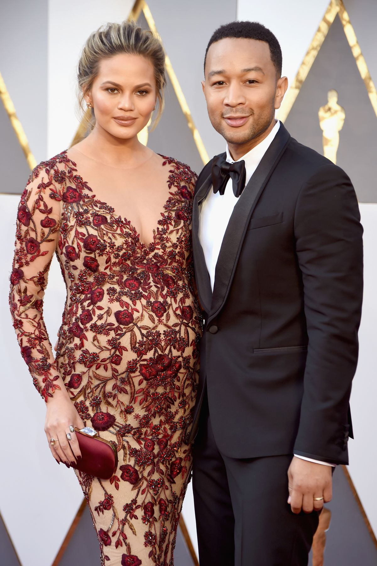 HOLLYWOOD, CA - FEBRUARY 28: Model/TV personality Chrissy Teigen (L) and musician John Legend attend the 88th Annual Academy Awards at Hollywood & Highland Center on February 28, 2016 in Hollywood, California. (Photo by Jeff Kravitz/FilmMagic)