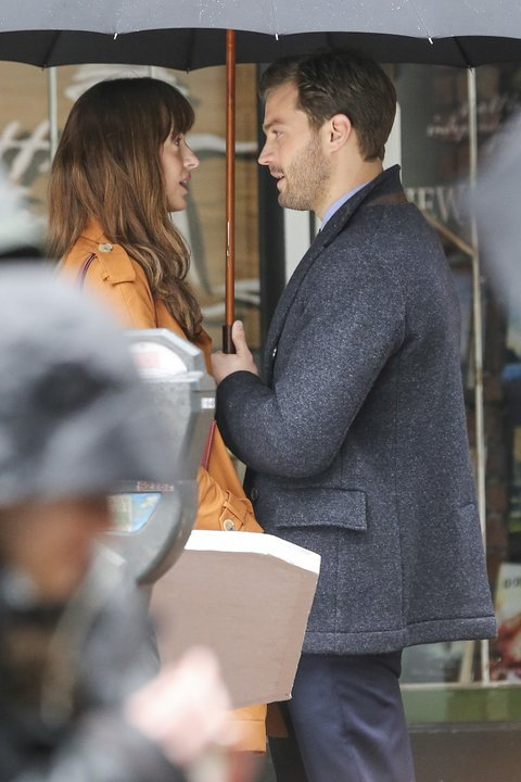 Jamie Dornan and Dakota Johnson are back in Vancouver to begin production on 'Fifty Shades Darker' the sequel to last year's $500M+ hit to 'Fifty Shades of Grey.' Now sporting some bad boy scruff, Jamie Dornan waits for Dakota Johnson outside of 'Seattle Independent Publishing' the company Anastasia Steele (Dakota) works at. They exchange a kiss before going for a brief walk where she gives Mr. Grey a present! Pictured: jamie dornan, dakota johnson Ref: SPL1234796  010316   Picture by: Splash News Splash News and Pictures Los Angeles:310-821-2666 New York:212-619-2666 London:870-934-2666 photodesk@splashnews.com
