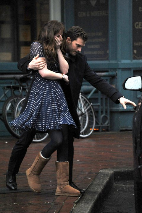 Dakota Johnson rushes into the arms of Jamie Dornan on set of Fifty Shades Darker in Vancouver! The scene was filmed on location in trend gas town area of Vancouver. The rainy scene saw Anastasia Steele rush out of a coffee store into the arms of Christian Grey who helped her into a taxi while filming the sequel to Fifty Shades of Grey in Vancouver! Pictured: Dakota Johnson, Jamie Dornan Ref: SPL1237378  010316   Picture by: Splash News Splash News and Pictures Los Angeles:	310-821-2666 New York:	212-619-2666 London:	870-934-2666 photodesk@splashnews.com