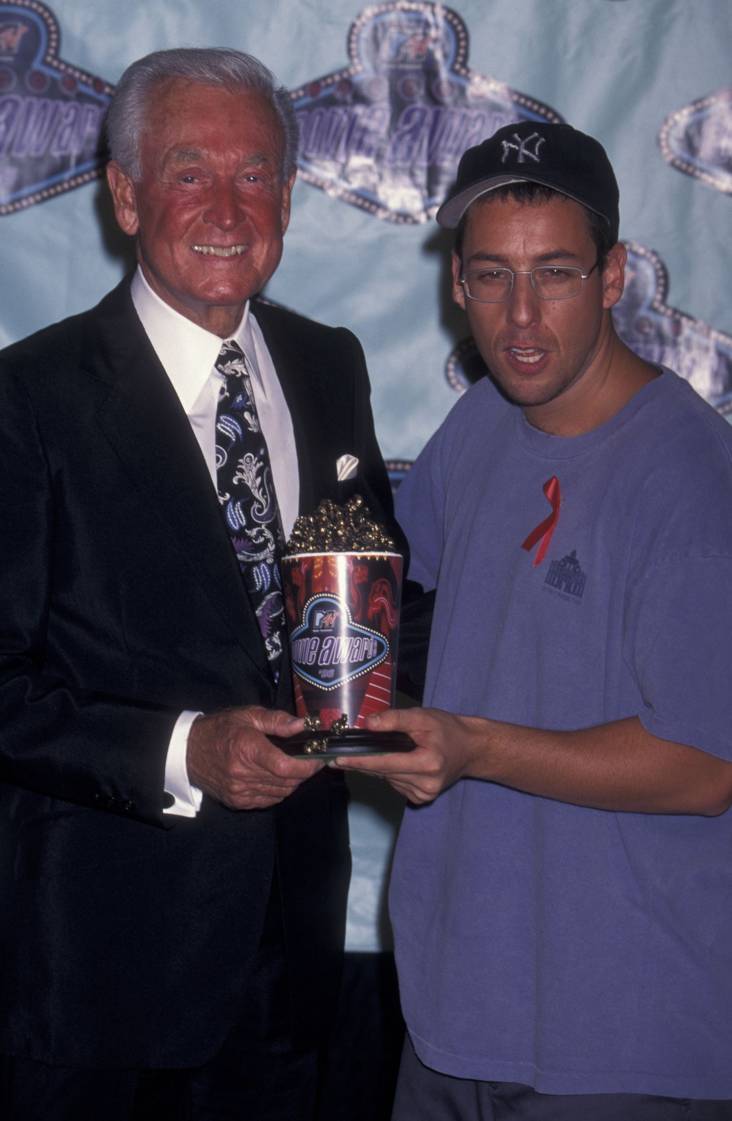 Bob Barker and Adam Sandler attend Fifth Annual MTV Movie Awards on June 8, 1996 at Disney Studios in Anaheim, California. (Photo by Ron Galella, Ltd./WireImage)