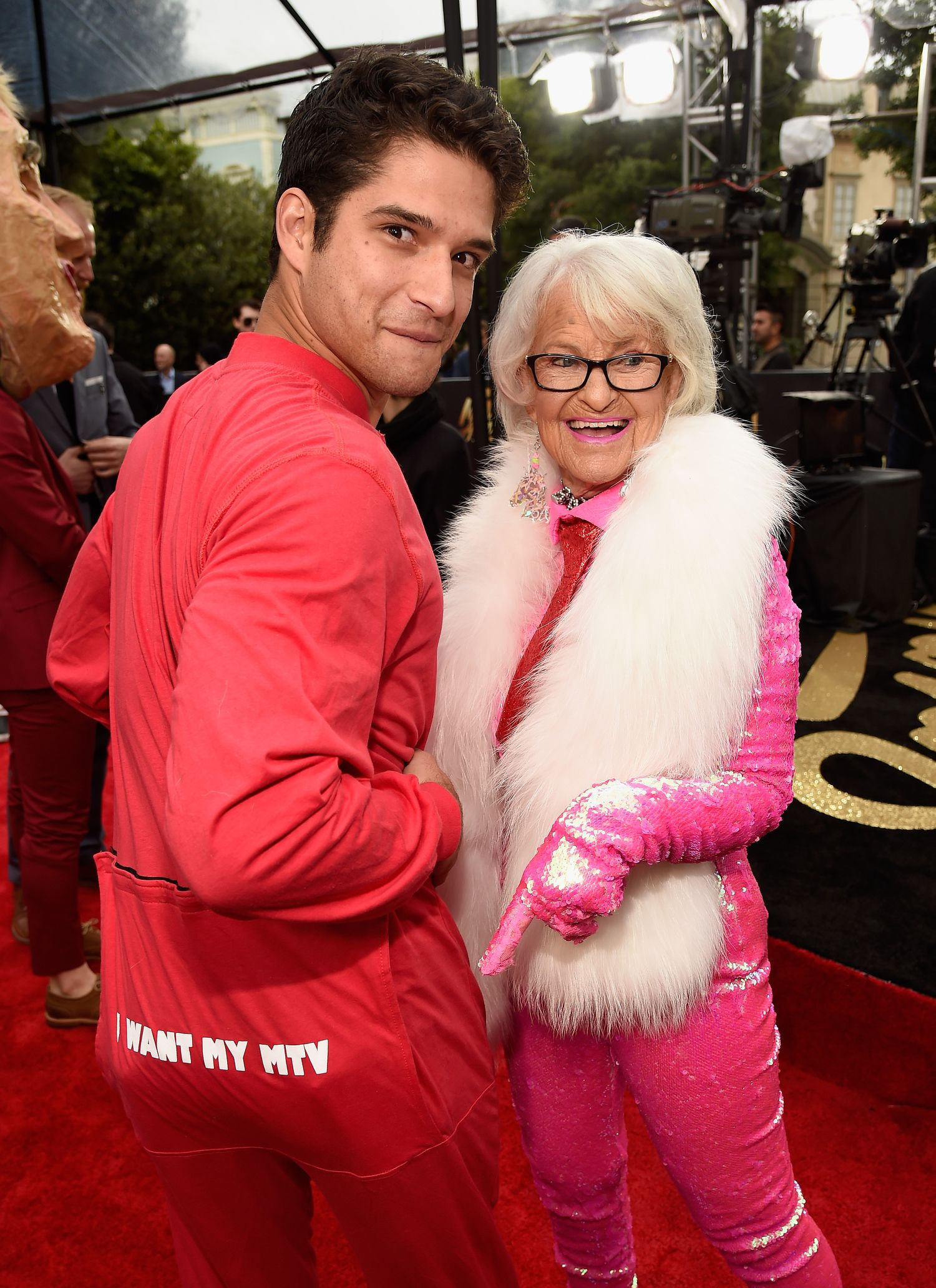 BURBANK, CALIFORNIA - APRIL 09: Actor Tyler Posey (L) and internet personality Baddie Winkle attend the 2016 MTV Movie Awards at Warner Bros. Studios on April 9, 2016 in Burbank, California. MTV Movie Awards airs April 10, 2016 at 8pm ET/PT. (Photo by Kevin Mazur/WireImage for MTV)