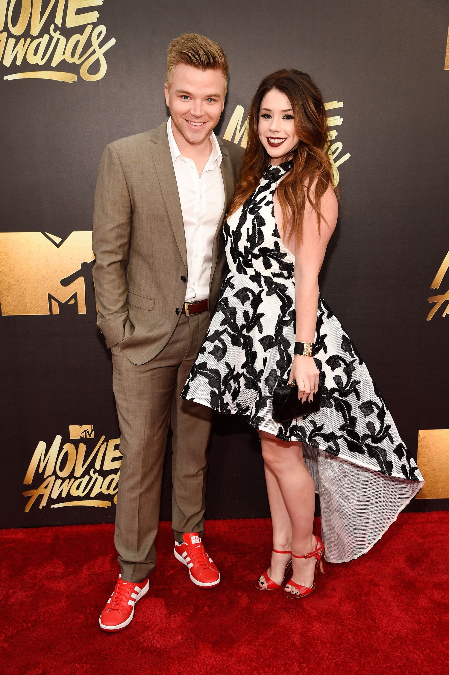 BURBANK, CALIFORNIA - APRIL 09: Actors Brett Davern (L) and Jillian Rose Reed attend the 2016 MTV Movie Awards at Warner Bros. Studios on April 9, 2016 in Burbank, California. MTV Movie Awards airs April 10, 2016 at 8pm ET/PT. (Photo by Kevin Mazur/WireImage for MTV)