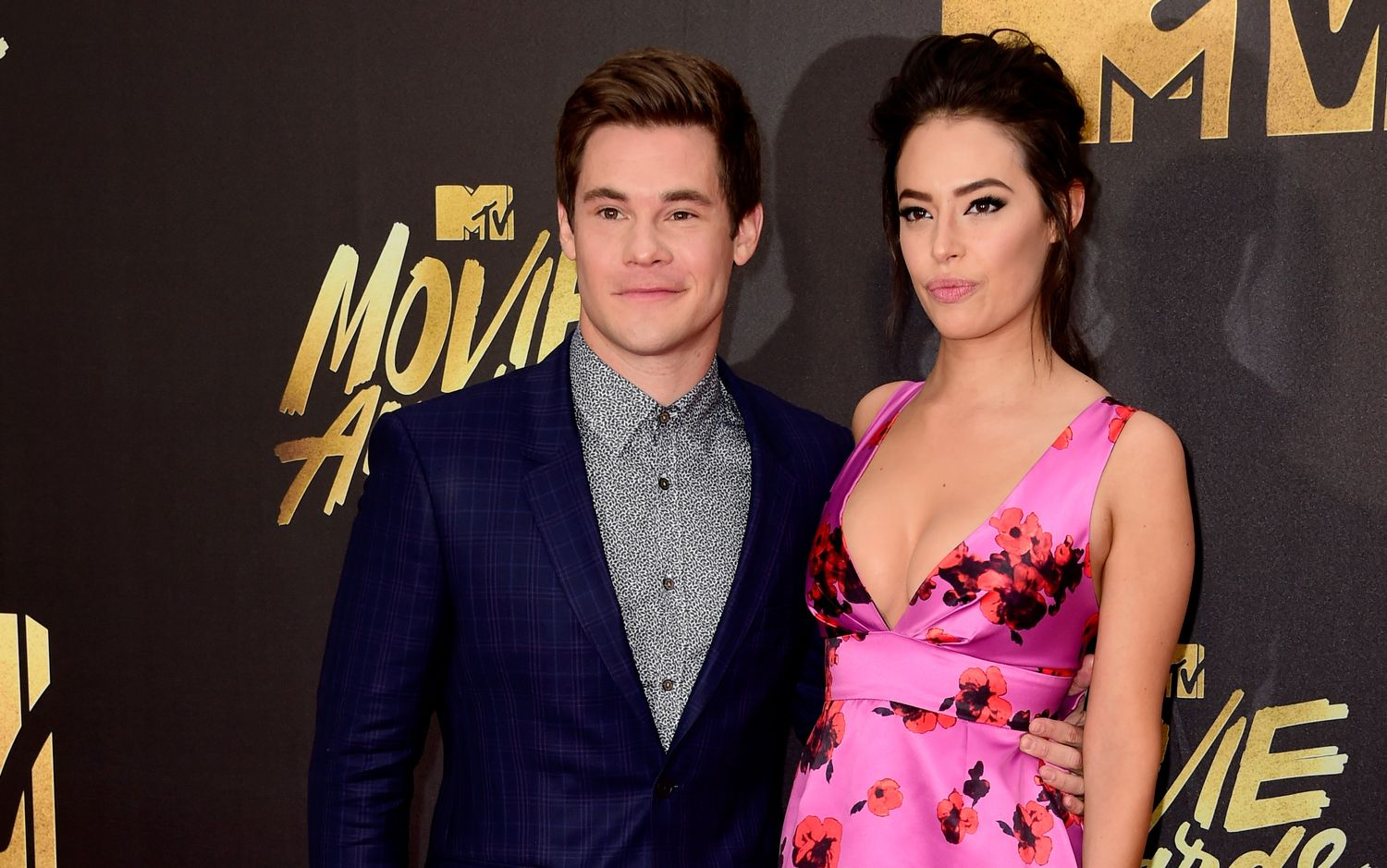 BURBANK, CALIFORNIA - APRIL 09: Actors Adam DeVine and Chloe Bridges attend the 2016 MTV Movie Awards at Warner Bros. Studios on April 9, 2016 in Burbank, California. MTV Movie Awards airs April 10, 2016 at 8pm ET/PT. (Photo by Frazer Harrison/Getty Images)