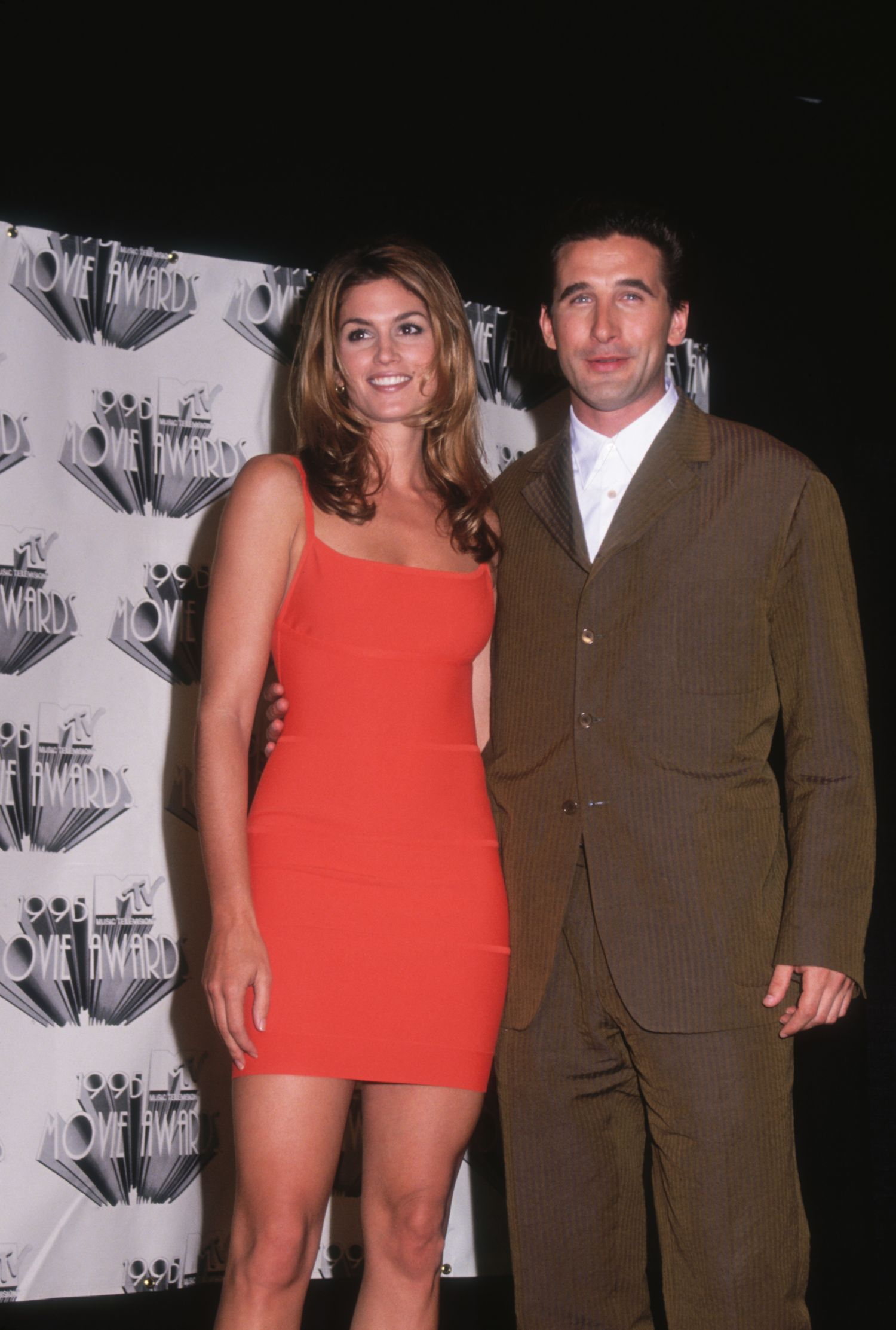 American supermodel Cindy Crawford poses with actor William Baldwin at the 1996 MTV Movie Awards. The two starred together in the 1995 thriller 'Fair Game'. (Photo by Darlene Hammond/Getty Images)