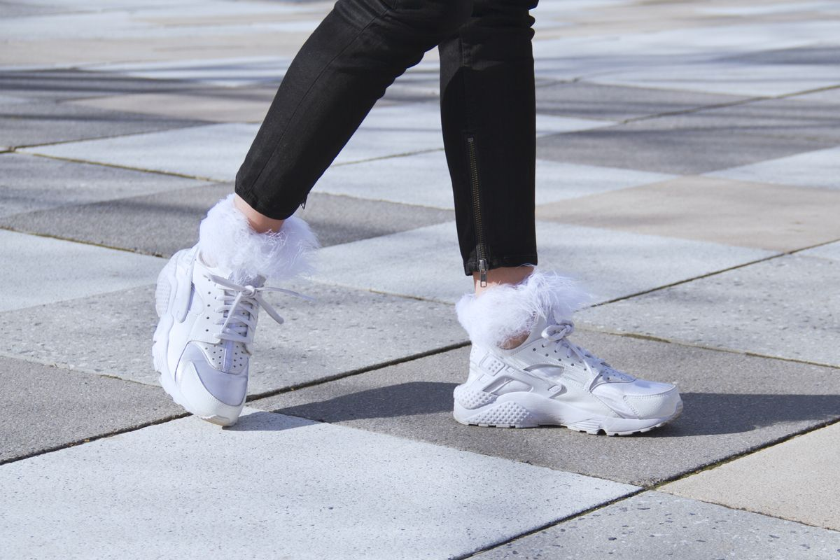 A New Yorker rocks some white socks with feather top by Rihanna with Stance this March.