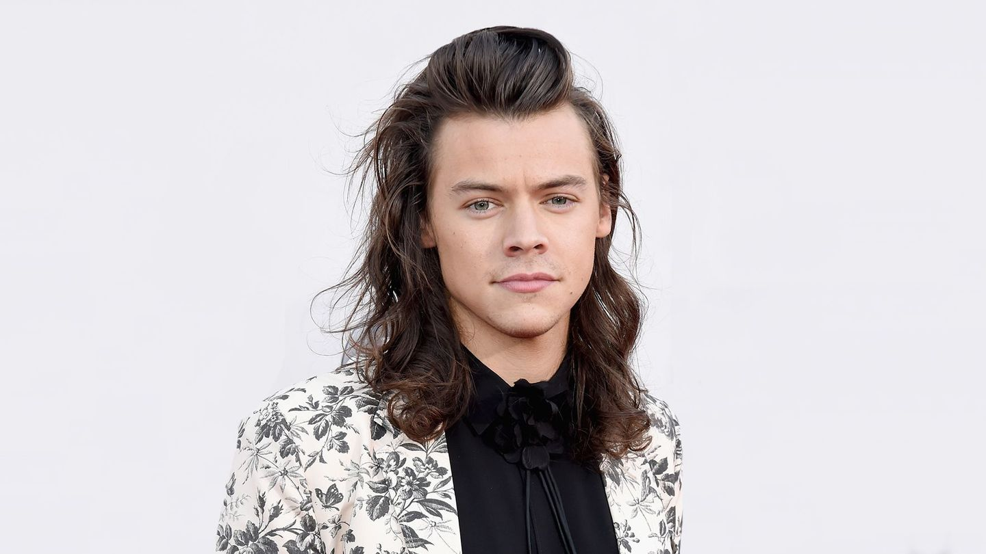 harry styles with hair harry styles finally reveals when he ll cut his hair mtv 1681